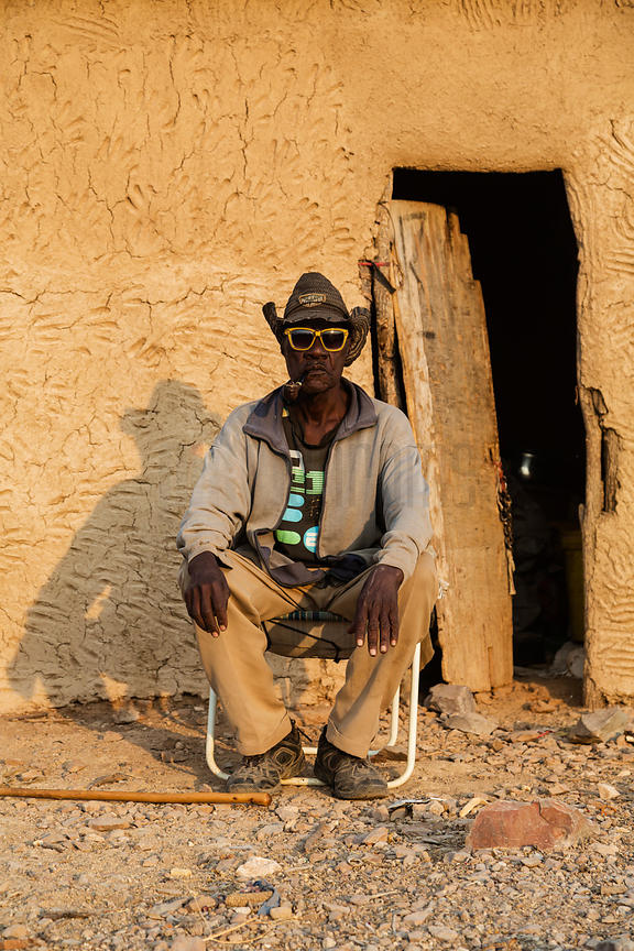 Portrait of a Herero man Smoking a Pipe
