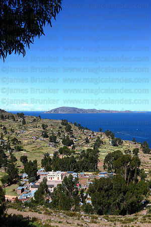 View of Llachon village, Taquile Island in background, Capachica Peninsula, Lake Titicaca, Peru