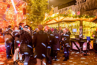 Drinkers enjoying the Santa Pauli Christmas Market in Hamburg