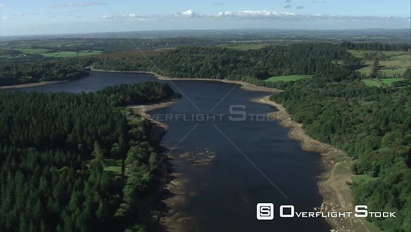Aerial view tracking over Burrator Reservoir, Dartmoor National Park, Devon, England, UK, October 2015.