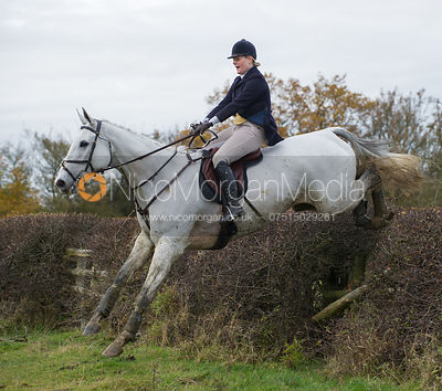 Kelly Morgan jumping a big Cottesmore hedge
