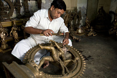 India - Swamimalai - Master craftsman Radhakhrishna Staphaty, works on the final touches to a statue of the dancing Nataraja ...