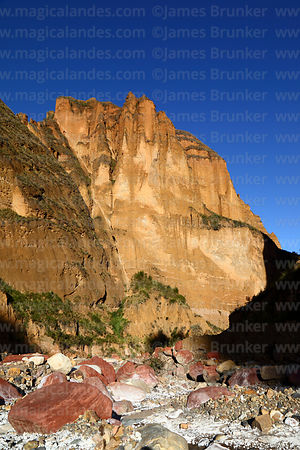 Red boulders in riverbed and rock formations in Palca Canyon, La Paz Department, Bolivia