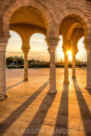 Sunshine behind traditional architecture columns