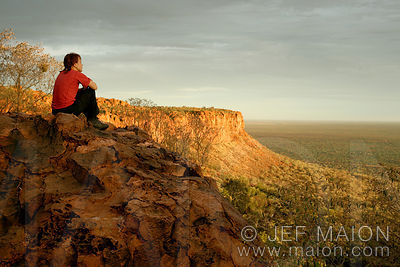 Woman watching sunset over plains