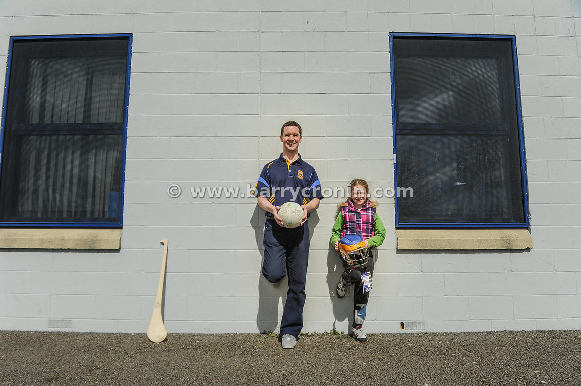 21st April, 2012. Castleknock GFC football nursery, Carpenterstown, Dublin. Pictured is Niall Tutty (Chairman) with Catherine...