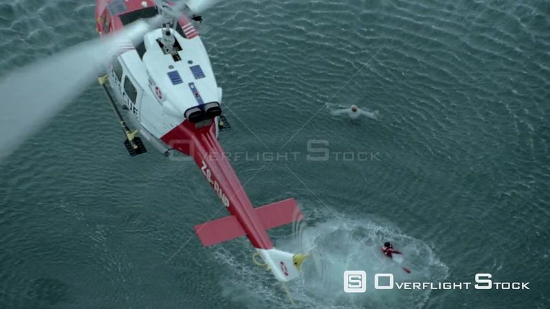 Aerial of a paramedic swimming towards a man below a rescue helicopter Cape Town Western Cape South Africa