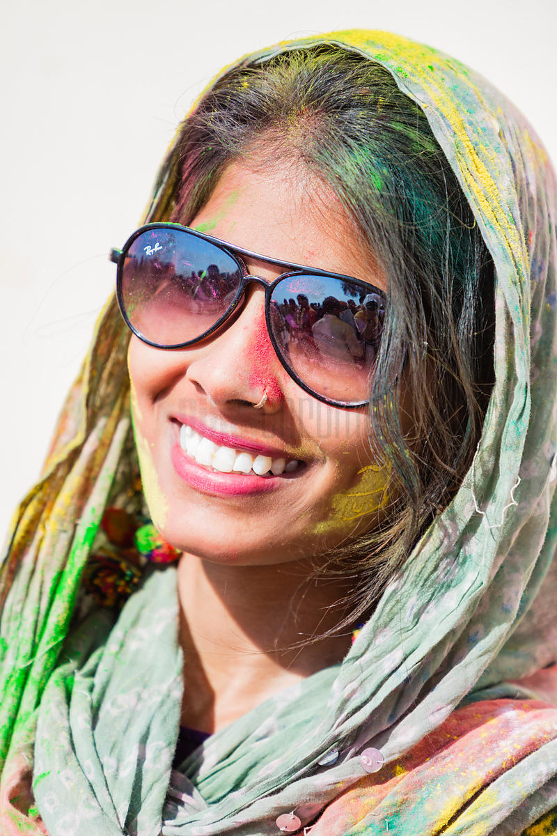Portrait of a Woman Playing Holi