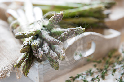 Freshly picked asparagus on a rustic tray