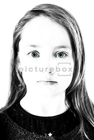 An image of a girl, in high contrast, looking forward – shot from eye level.
