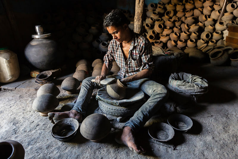 Young Man Shaping Pots with a Wooden Tool