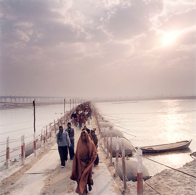 Pilgrims cross one of the many hundreds of bridges at the Kumbh Mela