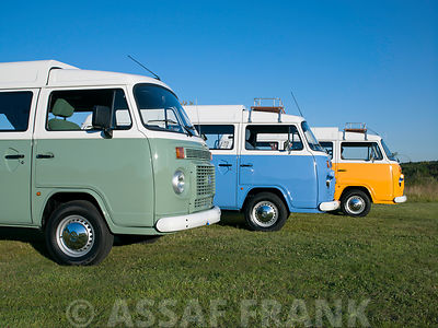 Three VW vans in a row