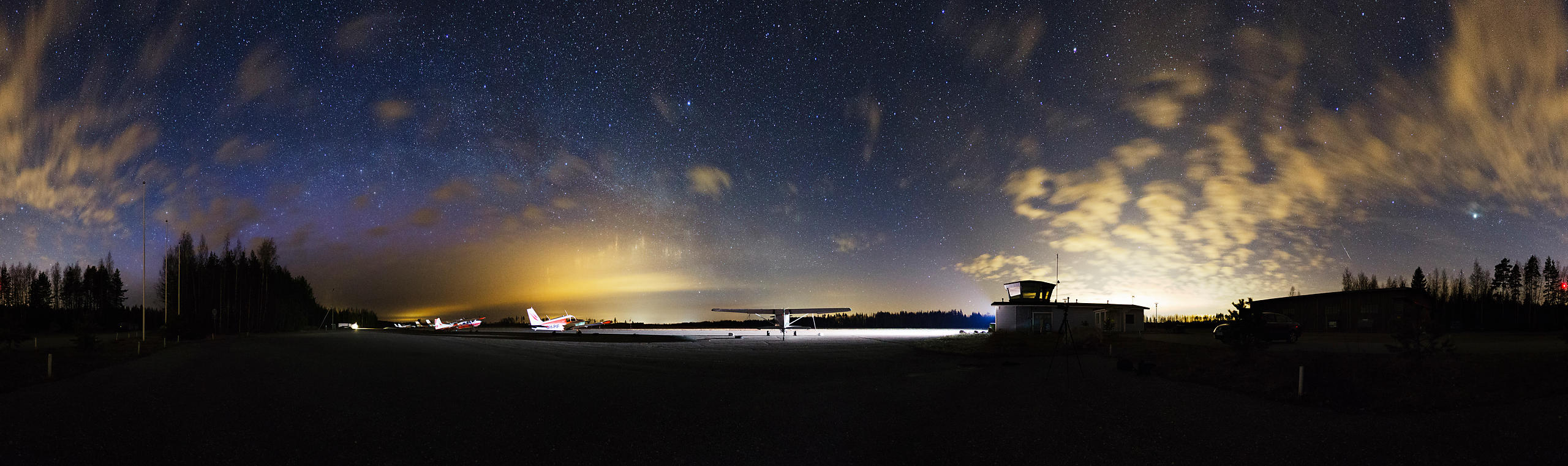 Light pillars, faint glow of northern lights and a lone Lyrid meteor at Vesivehmaa Airport on April 23 2015.