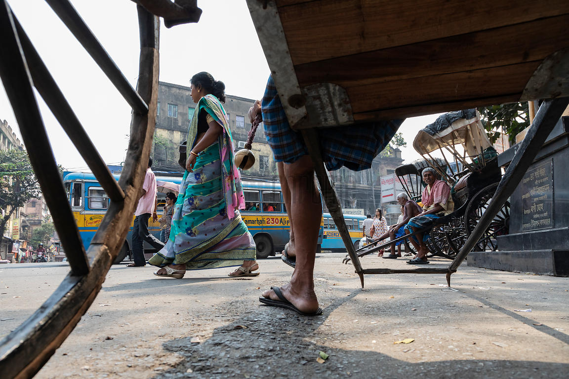 Rickshaw Wallahs Wait for a Fare