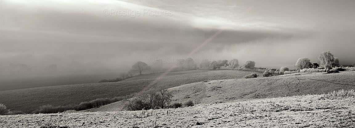 Stormy, frosty morning in the Cotswolds - panoramic