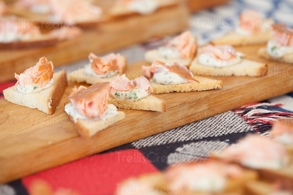 Delicious pieces of smoked salmon on toast appetizers