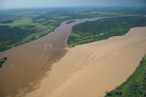Aerial view of Madeira River, where it is formed by the meeting of the waters of Beni River (clearer water, left) and Mamoré ...