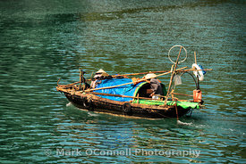 Fishing boat in Halong Bay Vietnam