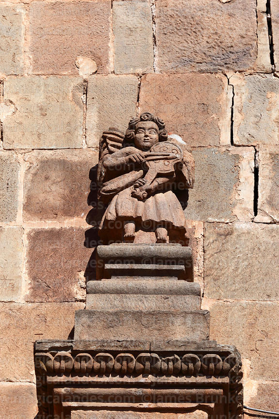 Detail of angel figure playing a violin on main facade of cathedral, Puno, Peru