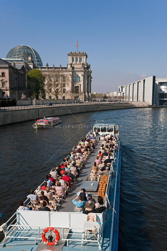 The Reichstag, German Government Parliament building, river Spree and a tourist boat, Berlin, Germany, 2007
