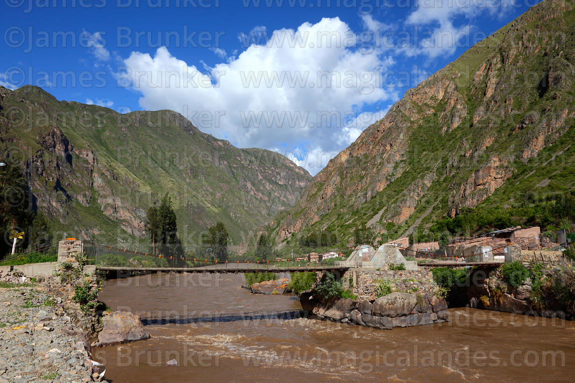 Bridge with Inca foundations across River Urubamba at Ollantaytambo, Sacred Valley, Peru