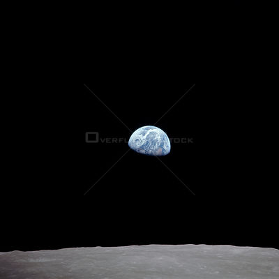 AS08-14-2384 (Dec. 1968)--- The rising Earth is about five degrees above the lunar horizon in this photograph-
