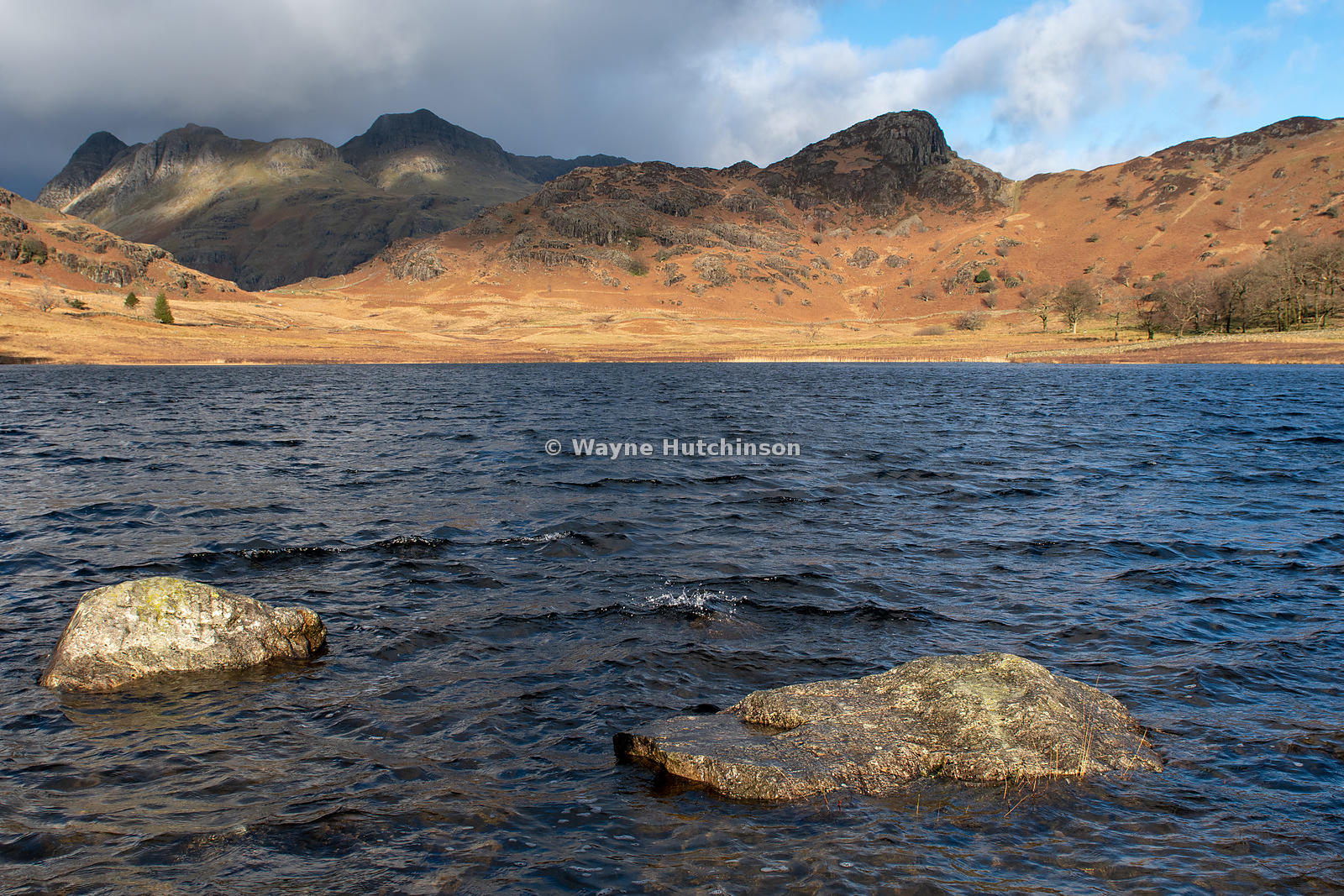 Blea Tarn in the English Lake District, looking towards the Langdales in late autumn / early winterCumbria, UK.