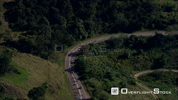 Aerial of cyclists riding through a mountainous area during a cycle race. kwaZulu Natal South Africa