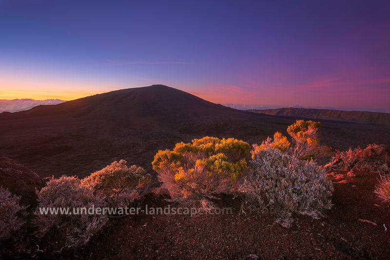 Colored sunrise on mountains - la reunion