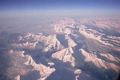 European Alps - aerial view in winter with snow on mountains
