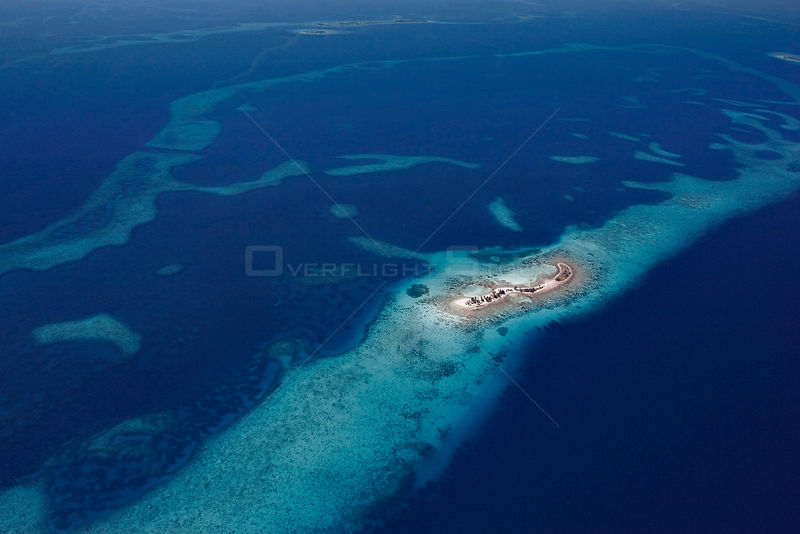Aerial view of Laughing Bird Caye, a narrow sand caye, Laughing Bird Caye National Park, southern Belize barrier reef. Belize...