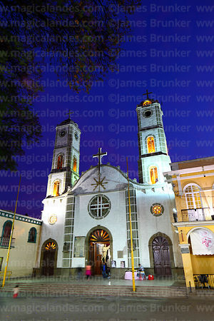 San Ildefonso church (home of the Virgen de Urkupiña) after sunset, Quillacollo, Bolivia