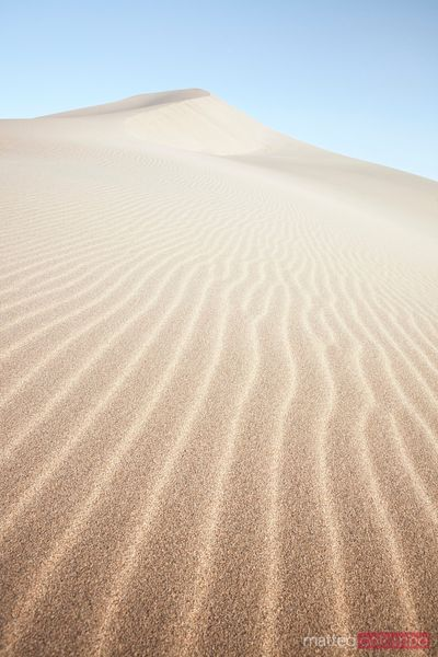 Sand dunes in the desert at sunrise, Dunhuang, China