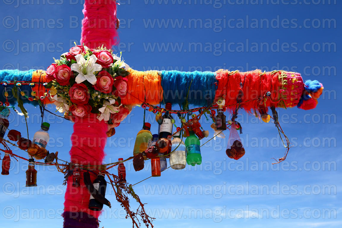 Detail of offerings for Pachamama (Mother Earth) on cross covered with wool, near Caspana, Region II, Chile