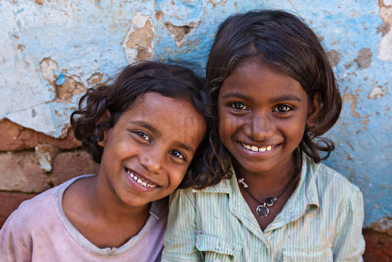 Portrait of Two Young Girls Smiling at Shanty Town