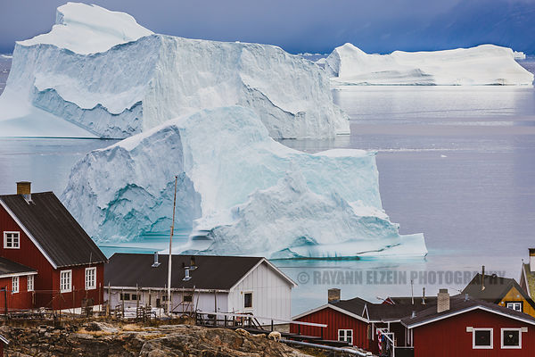 Massive icebergs in front of Uummannaq houses