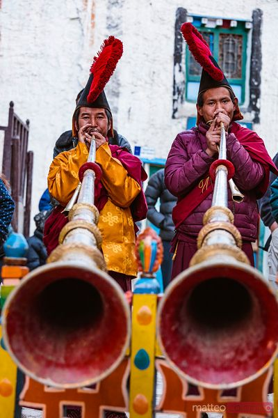 Monks playing tibetan horns,  Upper Mustang region, Nepal