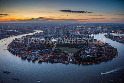 Aerial view of Isle of Dogs and Canary Wharf at sunset, London.