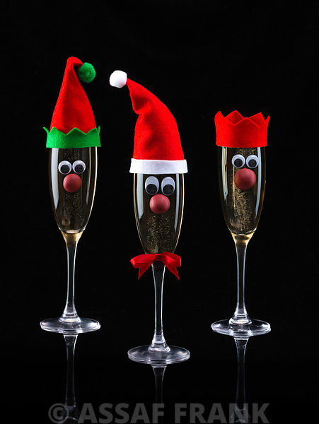 Champagne glasses decorated in Christmas theme