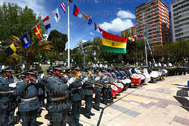 Military band playing below national flag during Dia del Mar / Day of the Sea events, Plaza Avaroa, La Paz, Bolivia