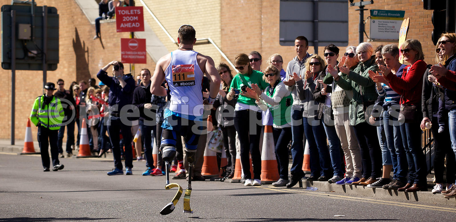 Richard Whitehead of Great Britain running in the IPC World Cup T42 event at the 2014 London Marathon