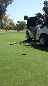 Man playing golf using an adaptive golf cart
