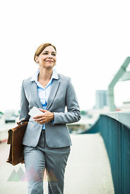 Businesswoman walking on bridge