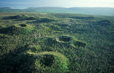 Aerial view of extinct volcano craters covered with forest. Savaii Western Samoa Polynesia