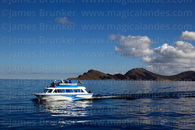 Tourist boat travelling to Copacabana, Sun Island in background, Lake Titicaca, Bolivia