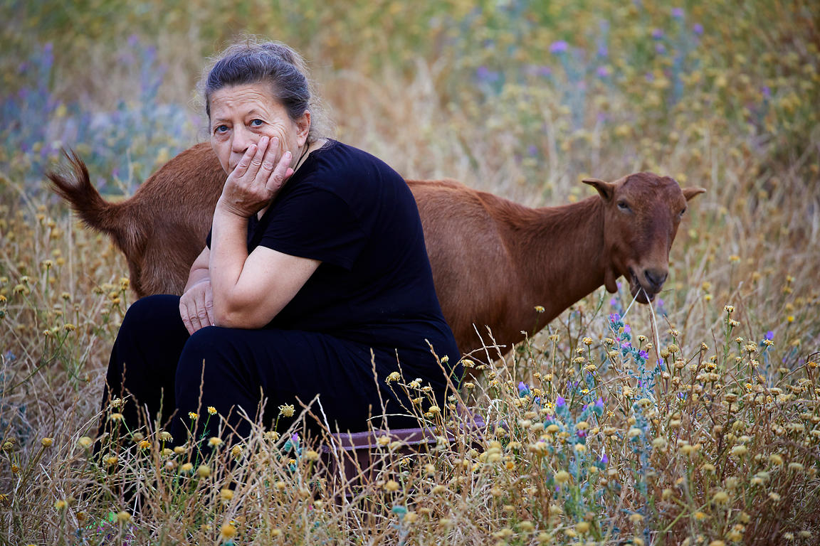Lady sat with her goat