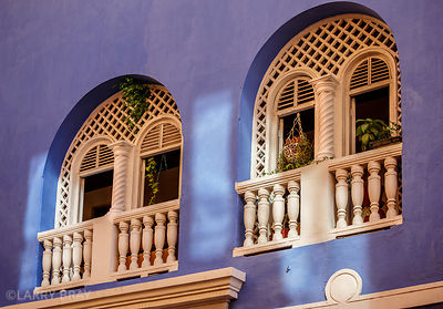 Arched windows in warm blue walls in Cartagena, Colombia, South America