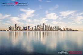 Qatar, Doha. Cityscape at sunrise from the Corniche
