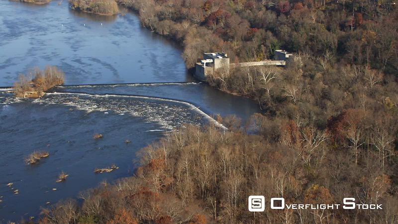 Flying over Little Falls Dam and Pumping Station on the Potomac River in autumn, Maryland shoreline at right. Shot in November